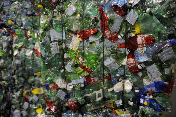 One green (PET, HDPE,PVC, LDPE, PP) bottle standing on thewall